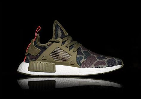 "We know BAPE already designed a couple of colorways of the adidas NMD R1, but did they whip up an NMD XR1 too? This first look at a ""Duck Camo"" style of the newest NMD model surfaces today, and while … Continue reading →"