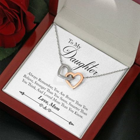 """The perfect keepsake for your Daughter from Mom.* Two hearts embellished with Cubic Zirconia stones, interlocked together as a symbol of never-ending love. * Made with high quality polished surgical steel. * Cable chain measures 18"""" with a 4"""" extension, and fastens with a lobster clasp.* Made in the USA.Pendant Dimensions:• Height 0.6"""" (1.5cm)• Width 1.1"""" (2.7cm)• Adjustable cable chain 18""""-22"""""""