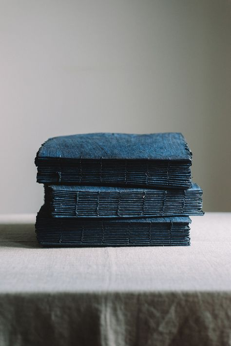 Beautifully ethereal handmade notebooks from France in a perfect indigo color. Featuring 90 pages in looped stitching. Wonderful for a wedding journal, flay lays, or a gift to a paper enthusiast. - Size : 7 in x 9.5 in - Materials : handmade paper - Provenance : new - Sourced from : France - Notes : 90 pages available (180 total with front and back)