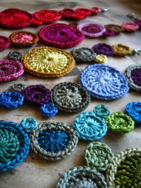 Crocheted circle and flower jewelry from floss. $44 on etsy. Seller: nadene