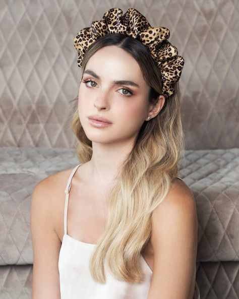 The iconic scrunchy transformed in to the perfect headband, with just the right volume and puffiness. Here in this leopard satin, so beautiful. You'll fall in love with it and feel so uplifted while wearing it! This particular one is so amazing with different hair tone colors, it blends and looks so fabulous and not too 'out-there'. Style it with a monochrome street style outfit, or something in nude and camel tones. Or go leopard all the way!  #hairaccessories #fashion #headband #leopard #style