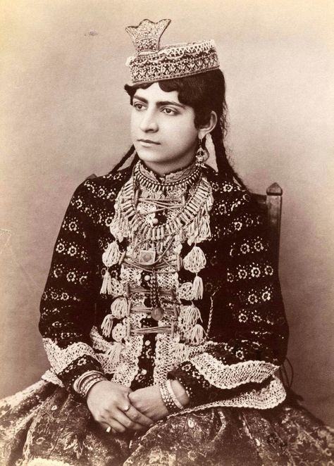 Iran (Persia) | Young girl in urban dress, featuring hat with crown ornament | ca. Late 19th to early 20th century | Qajar Dynasty