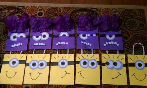 Purple evil minions and yellow minions for my Jenna Love. Used card stock for the eyes and stapled tissue paper (Walmart $.94) to top of purple bag for hair. Bags were 2 for $1 at Dollar Tree. White out for teeth.