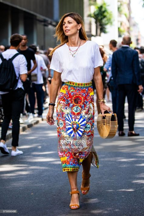 Alessandra Grillo wearing Dolce Gabbana skirt and wood bag is seen in the streets of Milan after the Dolce Gabbana show, during Milan Men's Fashion Week Spring/Summer 2019 on June 16, 2018 in Milan, Italy.