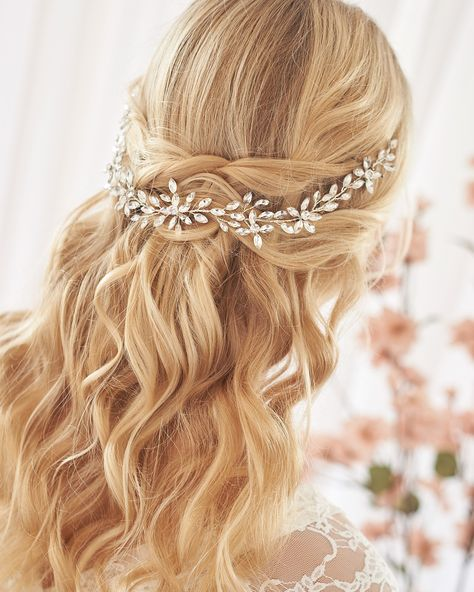 Turn every head as you walk down the aisle in our Felicia Crystal Hair Vine. With a bold, floral inspired design, Felicia features hand wired crystals that sparkle endlessly. Lightweight & easy to style. Designed with crystal gemstones. Measures 12 x 1.5 inches. Finish: silver. Pin loops are located at each end to secure in your hair with bobby pins or add ribbons here. Versatile & flexible, this hair vine can be worn as a headband, along the back of an updo, or wrapped around a bun. The Wedding Hair Half, Wedding Hairstyles Half Up Half Down, Long Hair Wedding Styles, Bridal Hair Vine, Wedding Hairstyles For Long Hair, Wedding Hair And Makeup, Wedding Hair Accessories, Down Hairstyles, Half Up Half Down Bridal Hair