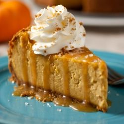 Pumpkin Cheesecake with Salted Caramel Frosting - looking for a Thanksgiving dessert? This is one you've got to try. #Thanksgivingrecipes #softfoodrecipes