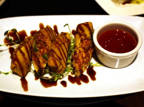Guy Fieri's NYC Restaurant : California Egg Rolls: Chicken, avocado, cabbage trio, ginger, garlic and red peppers served with sweet Thai chili dipping sauce.
