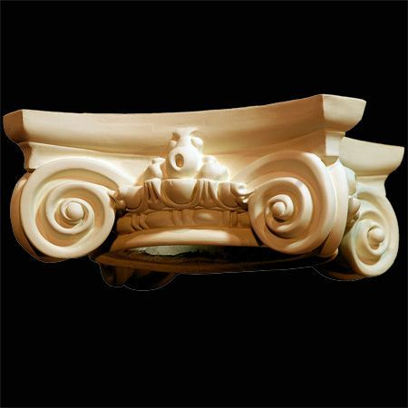"""Ionic Capital in Polyurethane, 14 3/4"""" X 14 3/4"""" across the top, 4 1/4"""" high can accommodate a column shaft 6"""" in diameter at the top and usually 8"""" diameter at the bottom."""