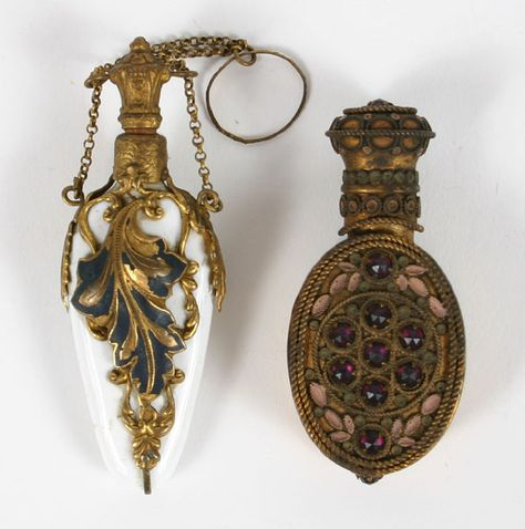 Lot of two Victorian chatelaine scent bottles. One glass on brass with enamel and filigree, stamped made in France on neck, and another with brass overlay on white glass
