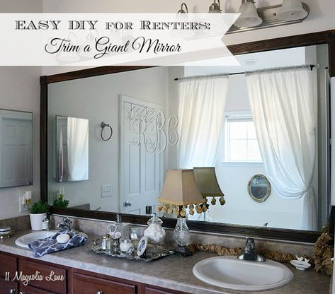 If you're a renter, you can still trim a HUGE bathroom mirror using a bit of hot glue and a single nail.  Inexpensive and so easy to remove when it's time to move--great idea for rental decor!