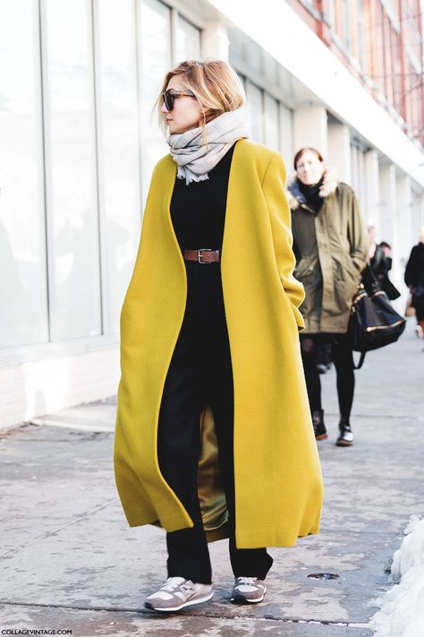 yellow coat over black + gray new balance sneakers