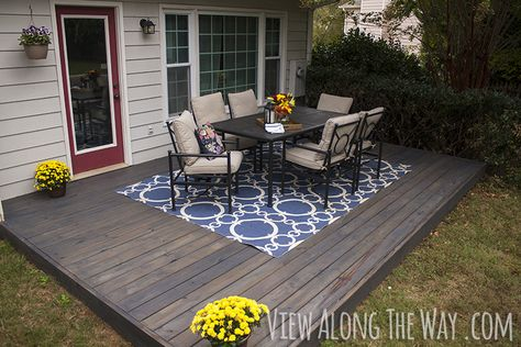 DIY deck over a concrete patio, and tips for staining your deck the easy way! Love the color!!!!