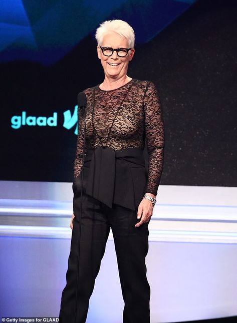 Jamie Lee Curtis cuts a sultry figure in sheer lace top and high-waisted trousers