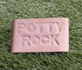"""Potty Rock -Prevent unsightly burn spots on your lovely green lawn. Cast cement tile is infused with a scent that dogs of all ages and both genders find irresistible. Place it in an area you want your dog to use, do a little training (including praise), and that's where your dog will go. Scent won't wash away in rain or deteriorate in sunshine. Nontoxic and reusable. 7"""" x 4 ½""""."""