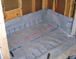 This Leaves Room For The Sloped Mortar Base And Waterproofing Membrane Which Laps Over The Plywood Subfloor At The En Universal Design Plywood Subfloor Design