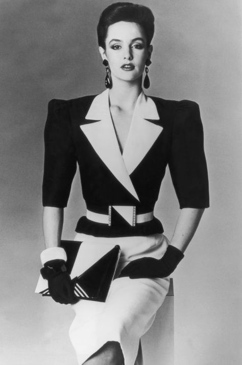 Shoulder Pads: The most prominent silhouette was the one that turned your body into an upside-down triangle. Add a couple giant earrings and a big belt, and you've got yourself an office power suit.
