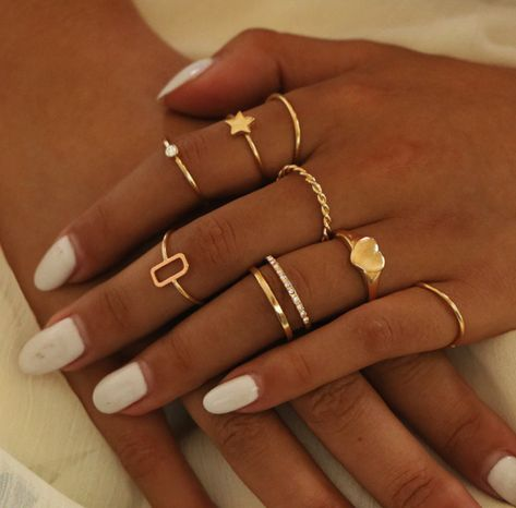 Boho finger jewelry set like these rings are perfect to flaunt your style. Petite sweet minimalist in style, mix and match to create your own unique boho look! They work well alone or layered together anyway you want. An assortment of creative shapes, and patterns featuring tiny CZ , twisted rope, solid heart and star, chic accessories. gold plate 9 ring set most are 2 mm width