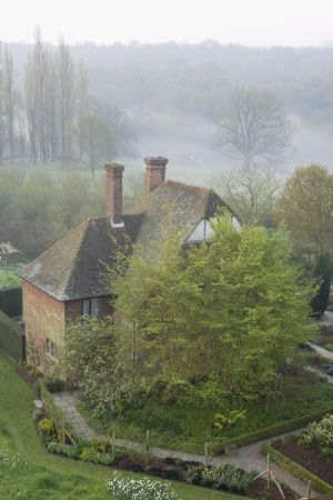 .Beautiful. Mist for Misty View over the South Cottage, at dawn, from the Tower at Sissinghurst Castle Garden, near Cranbrook, Kent