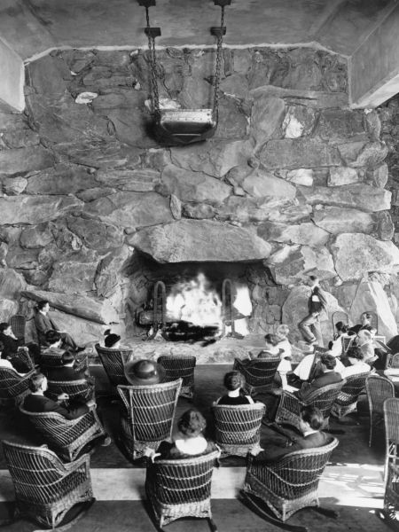 Vintage Picture Of People Gathering Around The Fireplace At The