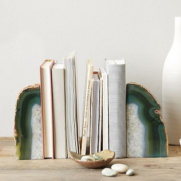 Agate Bookend: West Elm. $14. Perfect decorative accent for bookshelves. Also, the white (paper) book covers are super easy to make and are so fun! Placing some books on shelves backwards (pages facing out) adds interest.