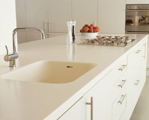 White Corian countertop,. Clean and bright..just right for a subway ...