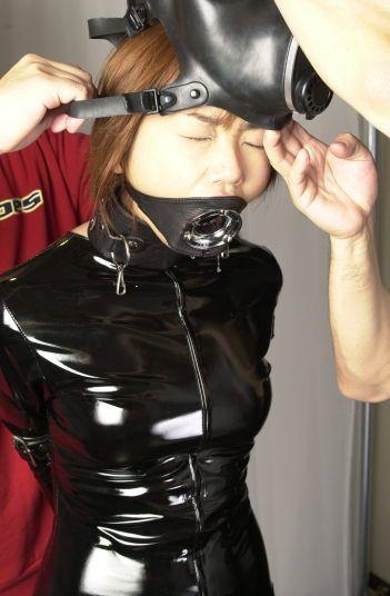 gagged Girl in latex
