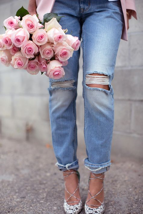Ripped boyfriend jeans and laced up heels