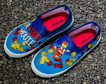 Hand Painted Shoes The Lego Movie Lego Themed Shoes That Have A Dark Blue Background Faded Glo Painted Shoes Hand Painted Shoes Vans Classic Slip On Sneaker