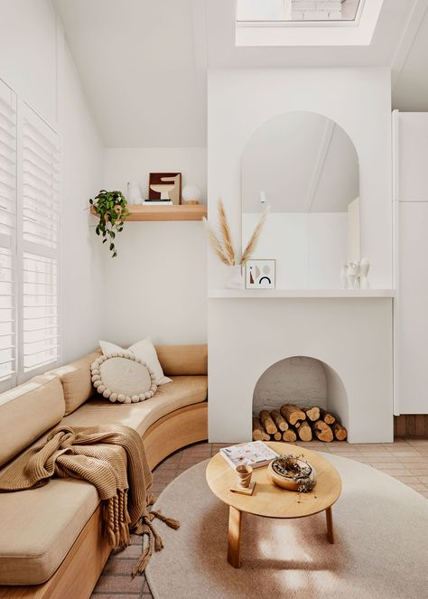 Tour the millennial pink Melbourne cottage of Josh and Jenna Densten. With tiled brick flooring, lush green plants, and soft textiles, this home is both cosy and stylish.
