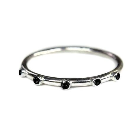 Sterling silver eternity ring, bezel set with 5 black spinelsThe band and stones are 1.5mm in sizeVery cute ring that can be worn alone or stacked with other rings.This can be made with other stones of your choice, prices may vary. Shipping: If you have a specific date by which you need this item to be made please let me know and I will try my best to meet your needs.*US sizing and sizing for other countries; you can let me know your size in your country in the notes (please say what country the