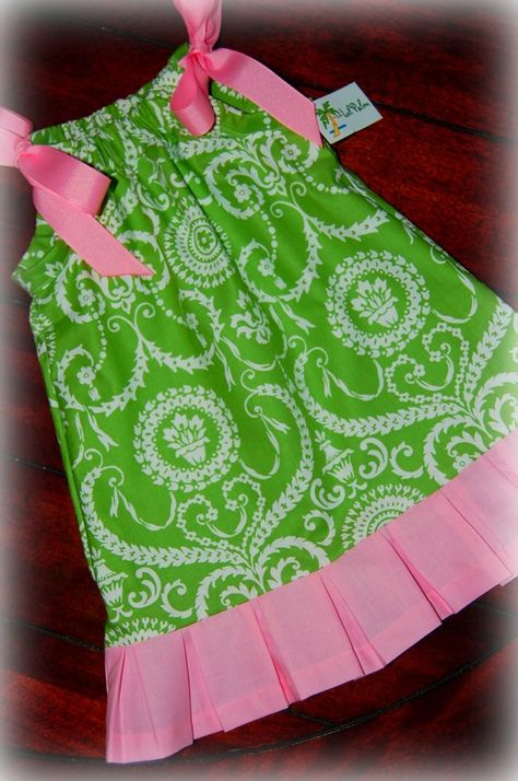 Lime Green Chadelier Print Pillowcase Dress with Grograin ribbon Ties at shoulder. Botton part is pleated in Pink.