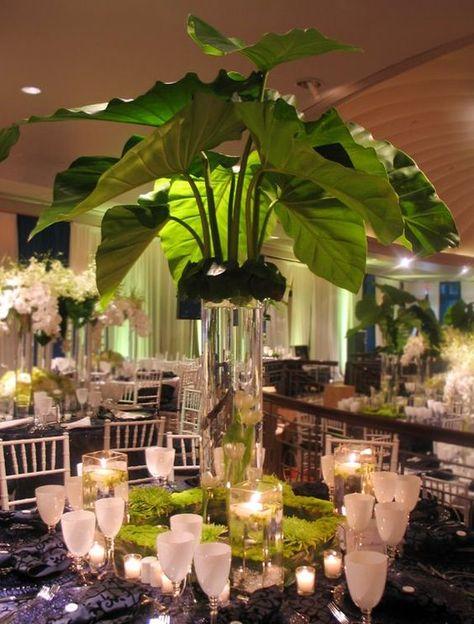 tropical reception wedding flowers / http://www.deerpearlflowers.com/tropical-leaf-greenery-wedding-decor-ideas/2/