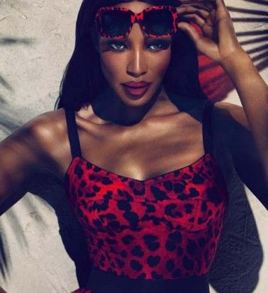 Naomi-Campbell in a Dolce & Gabana swimsuit.