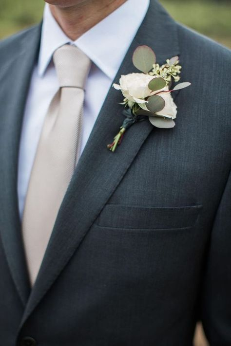 White rosebud eucalyptus leaves boutonniere groom attire taupe tie charcoal suit // Anna J Photography