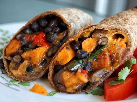 Sweet potato, black bean, and roasted pepper burritos seasoned with cilantro and lime via tastykitchen.com #healthy #tailgating