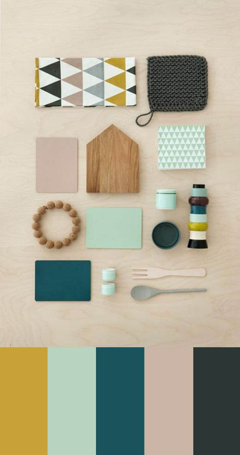 i like the colours - mint, yellow, grey, mink - and the display of natural wood, knit and geomettric shapes