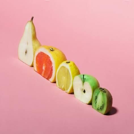 Various Fruits Sliced in Half. Minimal Concpet. Photographic Print by Zamurovic Photography | Art.co