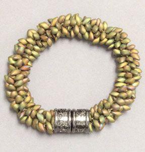 Magatama bead bracelet with beads randomly placed.
