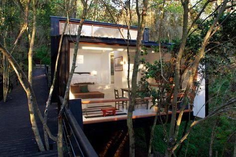 Forest Cabin On Stilts Accessed By Elevated Ramp Small House