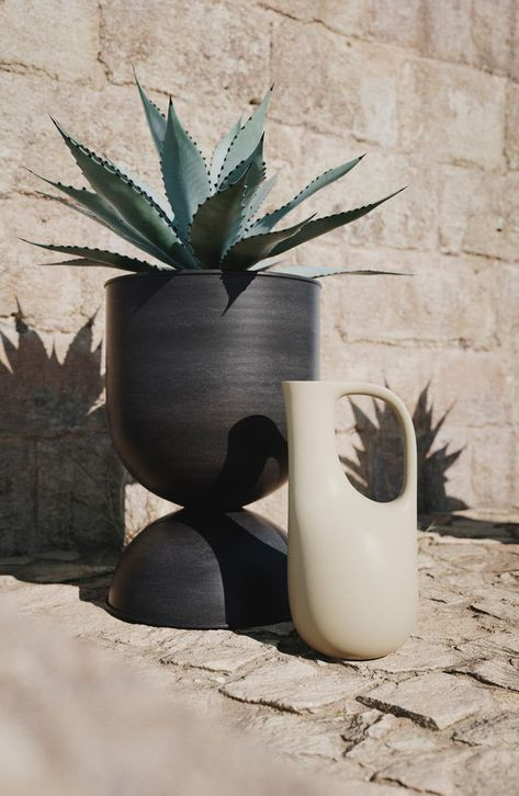 Graceful curves sculpt the shape of this art-as-watering-can made from post-consumer plastic waste to extend your green thumb to the planet.