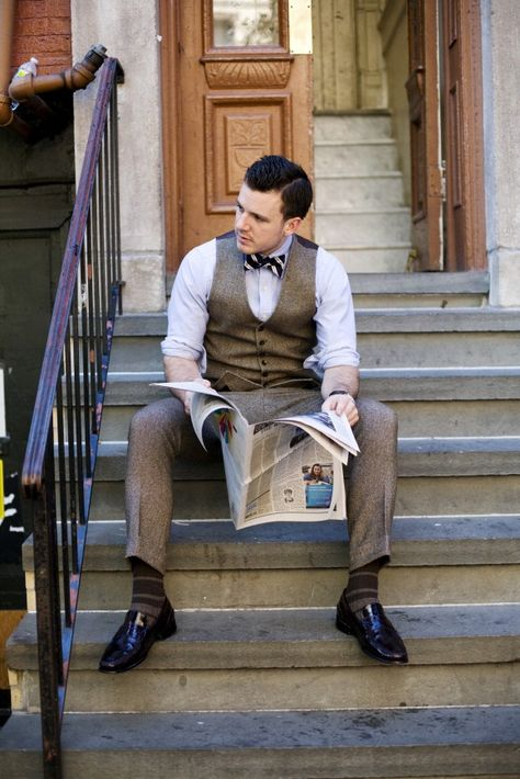 Dan Trepanier—3-piece tweed suit with navy-striped bow tie by Ralph Lauren Polo.