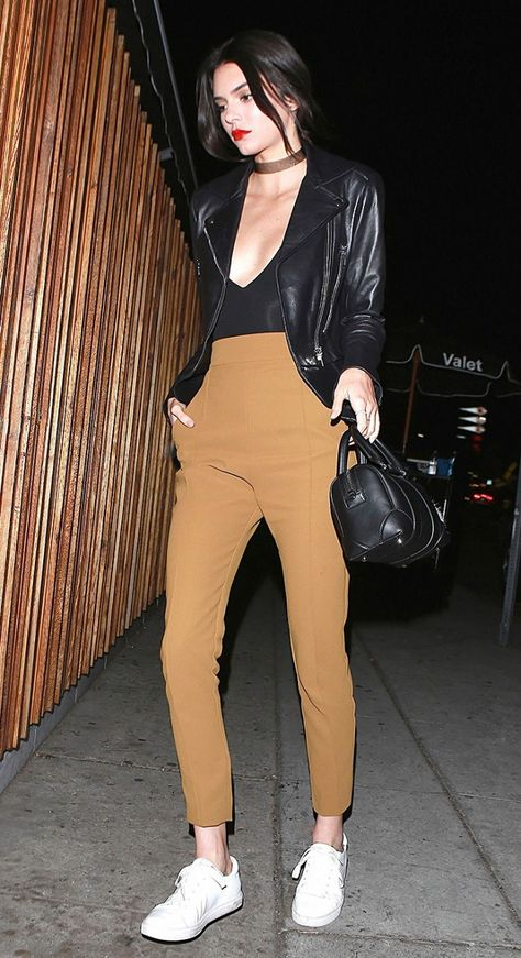 Kendall Jenner Wears Moto Jacket, Cropped Trousers, and White Sneakers