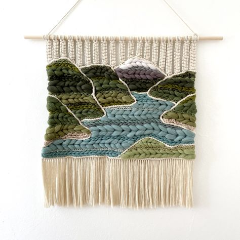 Diablo Lake in the North Cascades is known for is vibrant blue hue, captured in this macraweave landscape wall hanging. Dimensions: 26 inches wide x 23 inches long Colors: Leaf green, dark green, teal blue, aqua blue, tan brown, white, gray Materials: Cotton cord, wool roving, yarn How to Hang: This piece is ready to hang, all you need is a nail or thumbtack. Use a comb or brush to brush out the fringe at the bottom. What is Macraweave? Macraweave combines techniques of macrame and weaving. Abou