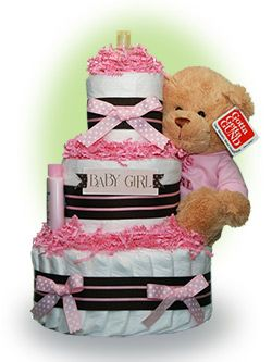 "Our Lil' Darling Girl diaper cake features an adorable plush teddy bear from Gund.  Also included are an ample set of diapers and a starter kit of baby care items from Johnson and Johnson.  The new mom will think of you as she uses these baby care necessities during the daily care of her ""Lil' darling"". Only $67.00"