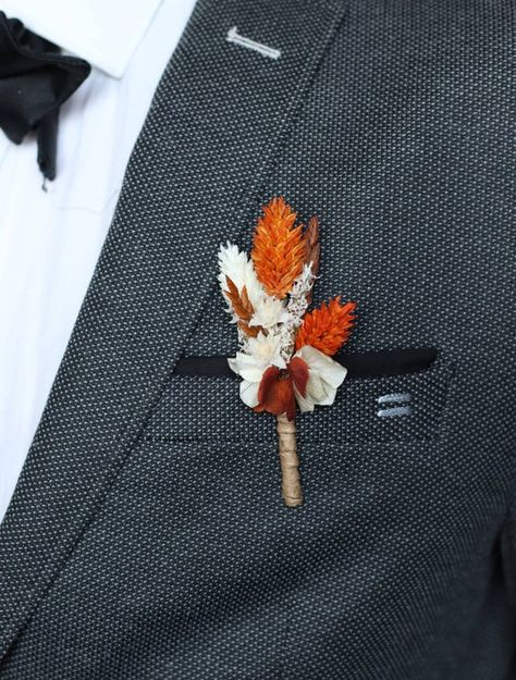 Terracotta buttonhole in dried and stabilized natural flowers for groom and witnesses