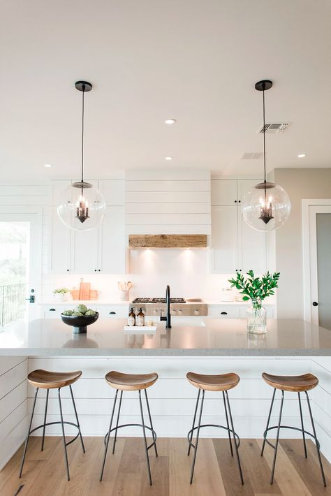 Beautiful kitchen design with white cabinets and glass dome pendant lights #whitekitchen #interiordesign