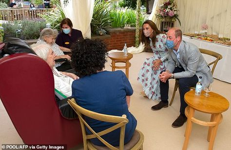 The Duke and Duchess of Cambridge speak with residents during their visit to Shire Hall Ca...