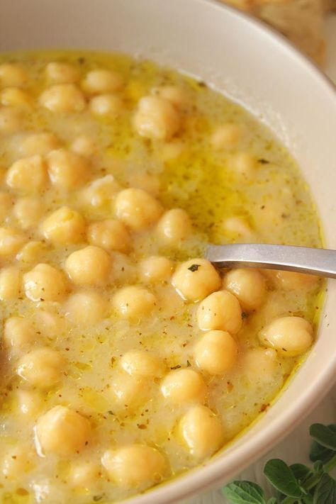 Greek Chickpea Soup - 30 days of Greek food This Greek chickpea soup has nutty, lemony flavor and buttery almost creamy texture. It is so comforting that it will warm your soul from the inside out. Chickpea Soup, Chickpea Recipes, Vegetarian Recipes, Cooking Recipes, Healthy Recipes, Lentil Soup, Chickpea Ideas, Healthy Greek Recipes, Quick Soup Recipes