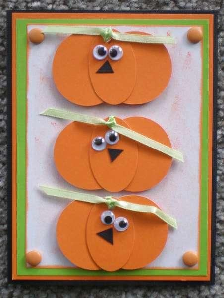 handmade Halloween card .... stacked trio of paper pieced pumpkins with googly eyes and triangle noses ... too funny!