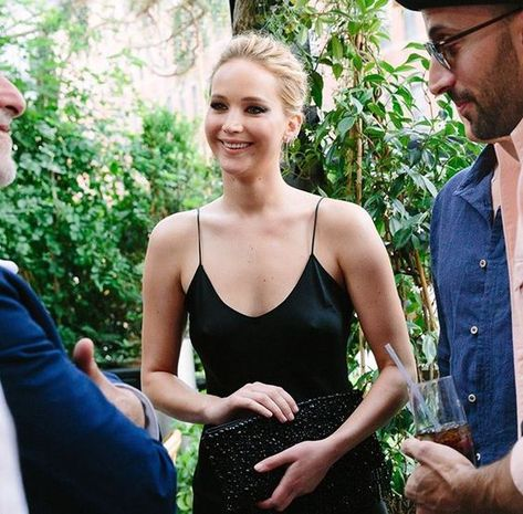 Celebrity in silk J Law in black silk slip dress